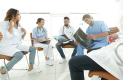 Group of surgeons and medical professional staff discussing on patient radiography Royalty Free Stock Photo