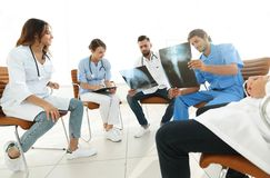 Group of surgeons and medical professional staff discussing on patient radiography Stock Photos