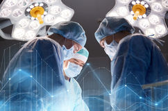 Group of surgeons in operating room at hospital. Surgery, healthcare, medicine and people concept - group of surgeons at operation in operating room at hospital Royalty Free Stock Image