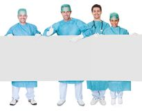 Group of surgeons presenting empty banner Stock Images