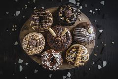 Group of sweet donuts. Group of sweet chocolate and homemade donuts,selective focus stock images