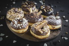 Group of sweet donuts. Group of sweet chocolate and homemade donuts,selective focus royalty free stock photos
