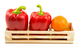 Group of sweet red peppers and ripe tangerine Stock Image