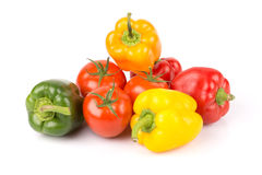 Group of sweet vegetables: yellow, orange, green, red paprika and freshness tomatoes. Stock Photography