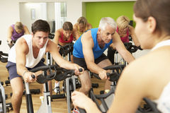 Group Taking Part In Spinning Class In Gym Stock Photo