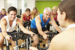 Group Taking Part In Spinning Class In Gym Royalty Free Stock Images