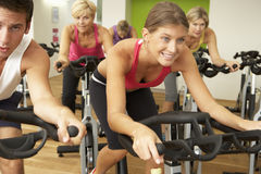 Group Taking Part In Spinning Class In Gym Stock Image