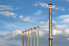 Group of tall chimney from steel factory under sky Royalty Free Stock Photos