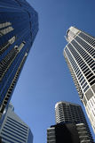 Group of tall modern financial district skyscraper buildings with deep blue sky, copy space Stock Photos