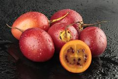 Group of tamarillos on black background Royalty Free Stock Images