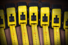Group of Tape Measures on Wooden Table Royalty Free Stock Photos