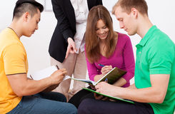 Group task at the lesson. And teacher Stock Images