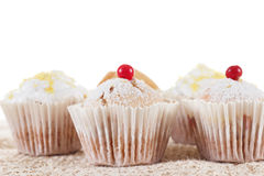 Group of tasty muffins isolated on a white stock photos
