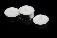 A group of Tea lights isolated on black background Stock Images
