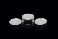 A group of Tea lights isolated on black background Royalty Free Stock Photo
