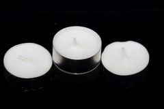 A group of Tea lights isolated on black background Stock Photography