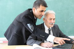 Group Of Teachers In Classroom. Stock Images