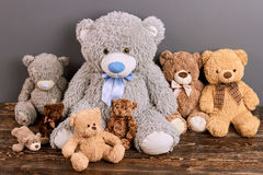 Group of teddy bears. Soft toys on brown wood. Online toy shop stock images