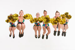 The group of teen cheerleaders jumping at white studio Royalty Free Stock Images