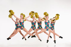 The group of teen cheerleaders jumping at white studio Royalty Free Stock Photos