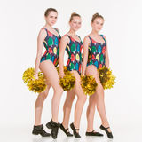 The group of teen cheerleaders posing at white studio Royalty Free Stock Images
