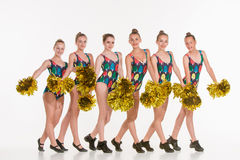 The group of teen cheerleaders posing at white studio Royalty Free Stock Photos