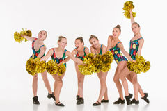 The group of teen cheerleaders posing at white studio Stock Image
