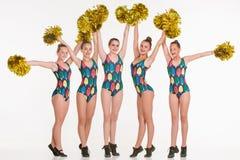 The group of teen cheerleaders posing at white studio Stock Photos