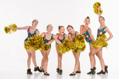 The group of teen cheerleaders posing at white studio Stock Images