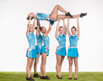 The group of teen cheerleaders posing at white studio Royalty Free Stock Image
