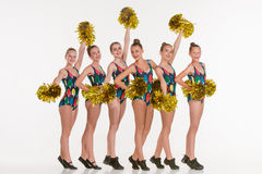 The group of teen cheerleaders posing at white studio Royalty Free Stock Photography