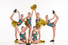 The group of teen cheerleaders posing at white studio Stock Photo