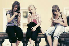 Group of teen girls calling on cell phones. Outdoor Stock Photos
