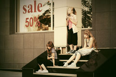 Group of teen girls on the mall steps. Group of teen girls sitting on the mall steps Stock Images