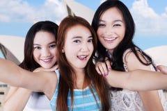 Group of teen girls taking photo Royalty Free Stock Photo