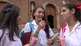 Catholic School Girls Drinking Beverages. A group of teen school girls Royalty Free Stock Photo
