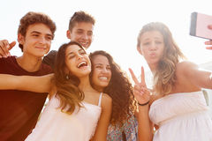 Group Of Teenage Friends Dancing And Taking Selfie Stock Photos