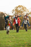 Group Of Teenage Friends Having Piggyback ride. S In Autumn Landscape Royalty Free Stock Photos