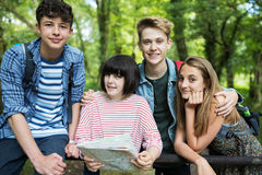 Group Of Teenage Friends Hiking In Countryside Together stock photos