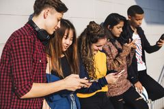 Group of teenage friends outdoors lifestyle and social media concept stock photo