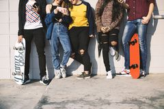 Group of teenage friends outdoors lifestyle and social media concept royalty free stock photo
