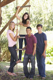 Group Of Teenage Friends By Treehouse Royalty Free Stock Photo