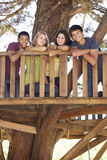 Group Of Teenage Friends In Treehouse Stock Photography