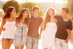 Group Of Teenage Friends Walking Along Street Royalty Free Stock Photography