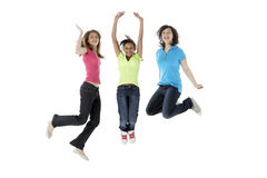 Group of Teenage Girlfriends Jumping in Studio Royalty Free Stock Photo