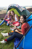 Group Of Teenage Girls On Camping Trip In Countryside Royalty Free Stock Photos