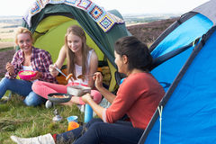 Group Of Teenage Girls On Camping Trip In Countryside Stock Photos
