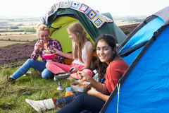 Group Of Teenage Girls On Camping Trip In Countryside Royalty Free Stock Photo