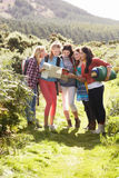 Group Of Teenage Girls On Camping Trip In Countryside Stock Image