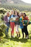 Group Of Teenage Girls On Camping Trip In Countryside. Smiling To Camera stock photo